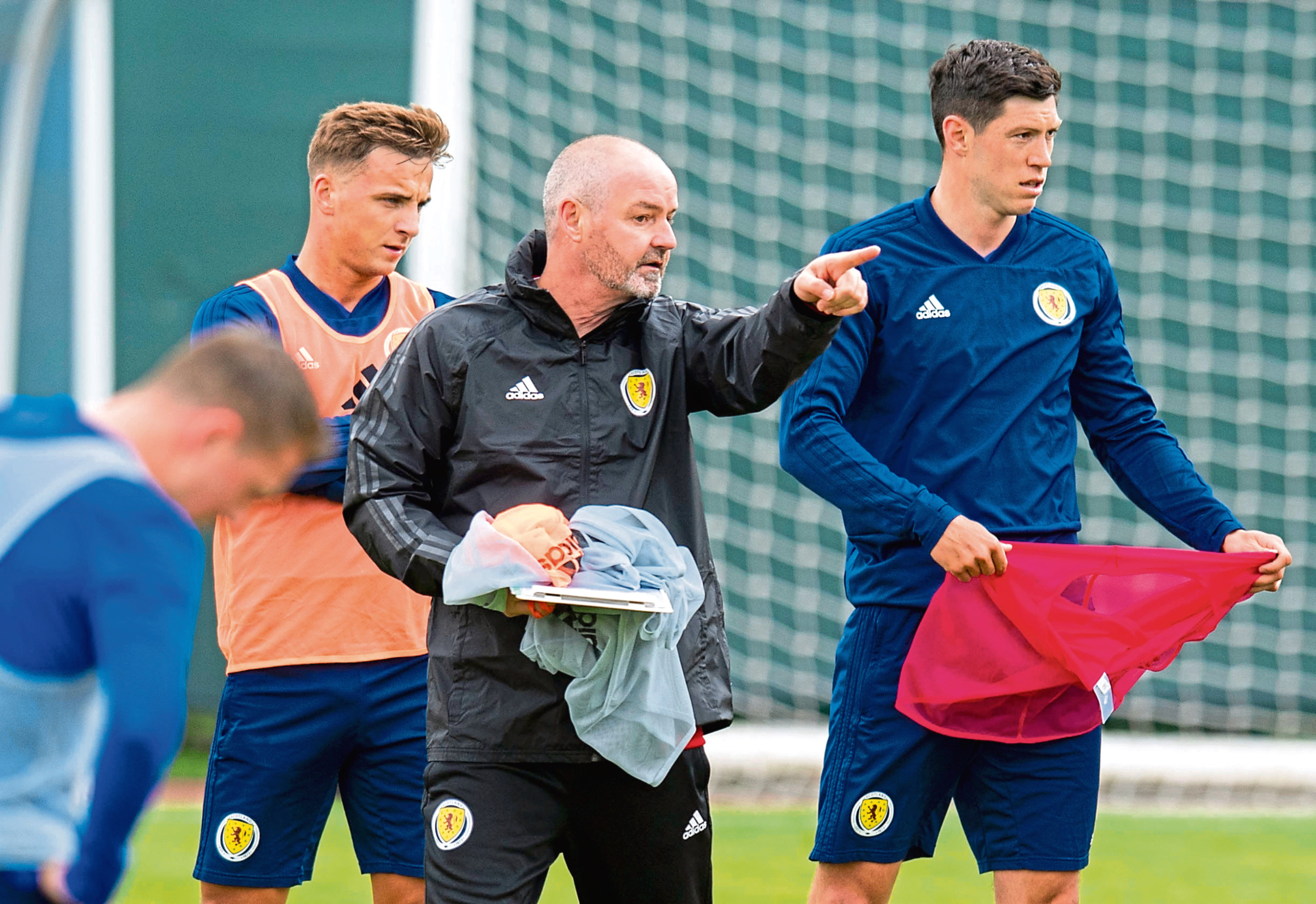 Steve Clarke speaks with Scott McKenna during training.