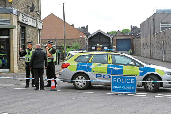 Police at the scene of the incident today.