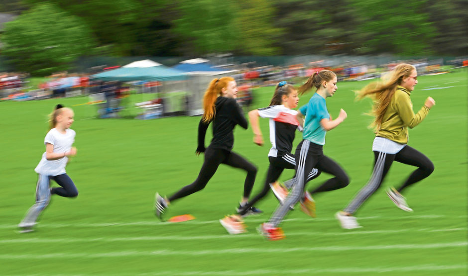 A heat of the P7 Girls 400m race.