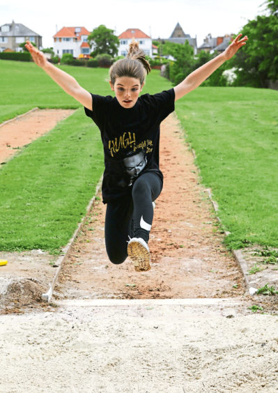 Lilly Hosie, St. Andrews PS competing in the long jump.