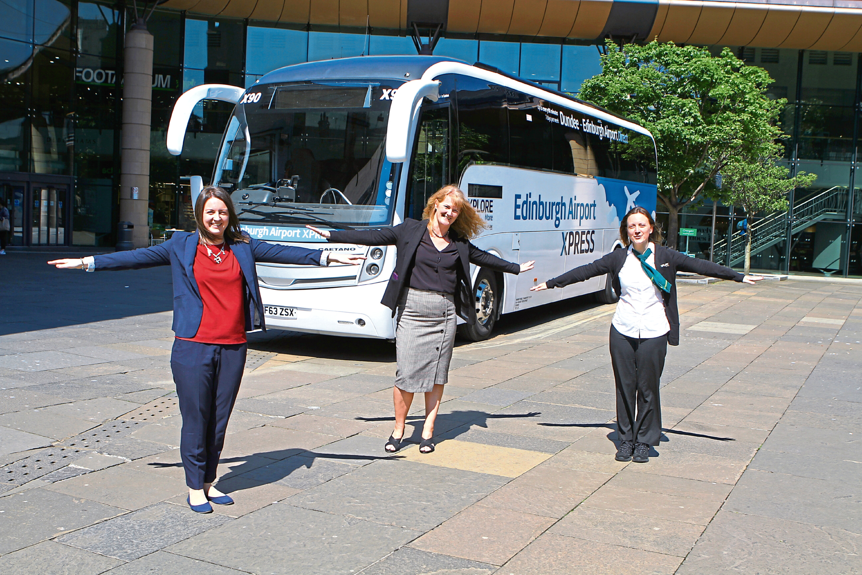 Frrom left: Kirsty Medine, financial business controller, Christine McGlasson and Gillian Scrimgeour, supervisor at Xplore Dundee Travel Centre, with the new bus.