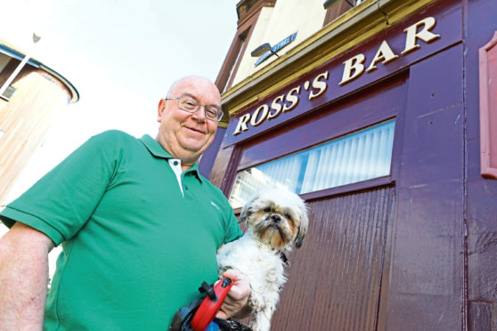 George Cumming with his Shih Tzu, Hanna  outside Ross's Bar.