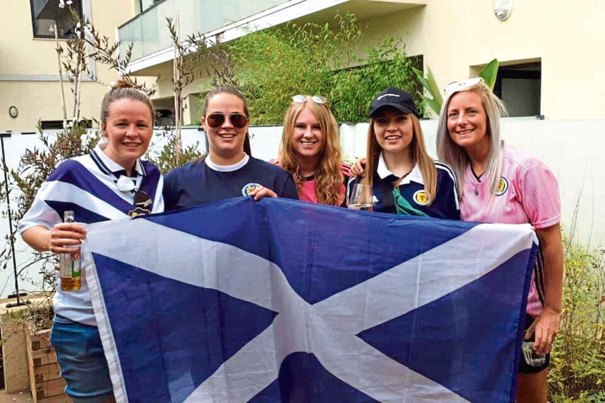 Laura Boag, far left, with friends in Nice, France, and displaying her prowess at keepy-uppy in the fan zone.