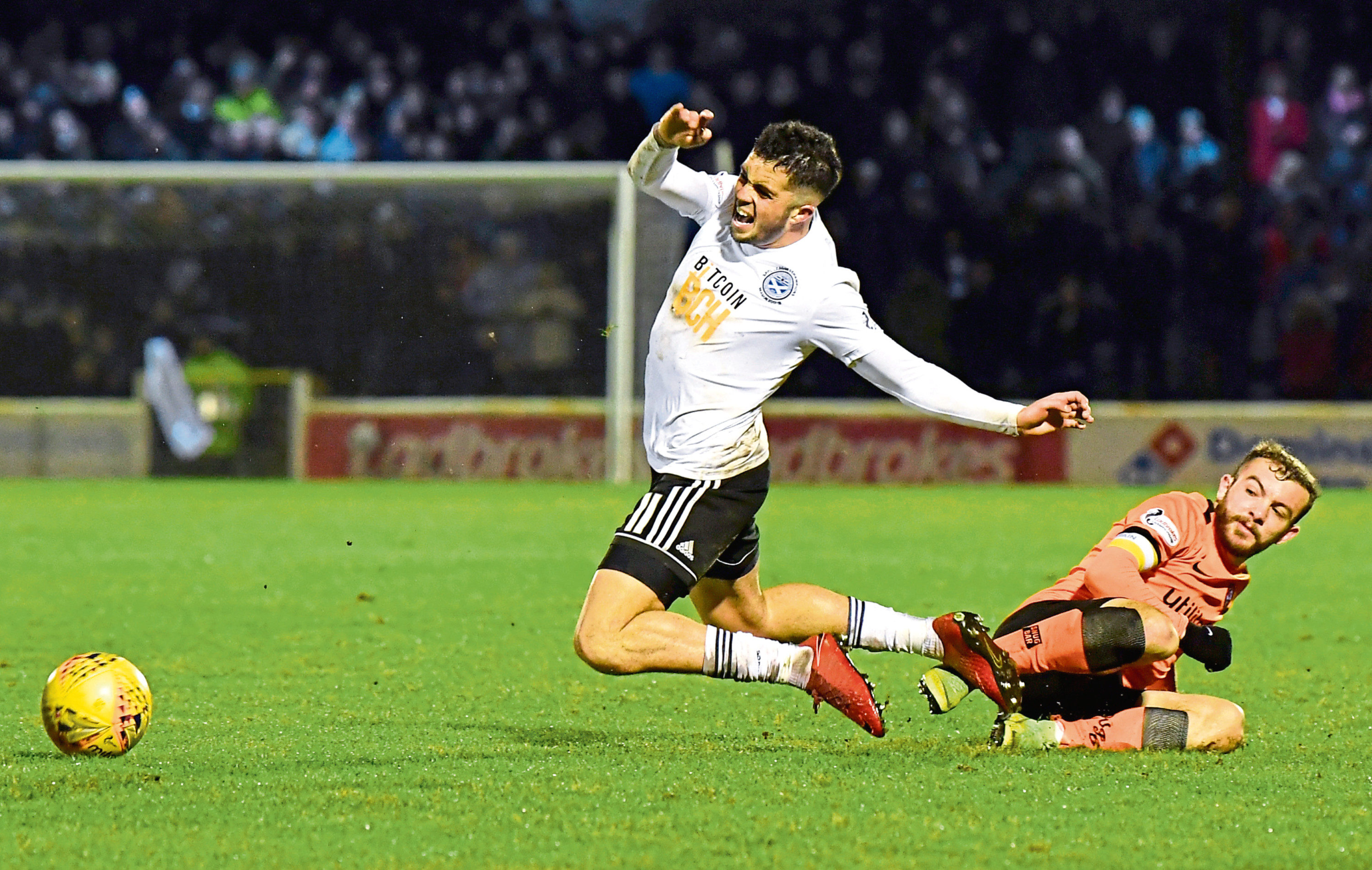 Declan McDaid is fouled by Dundee United's Paul McMullan.