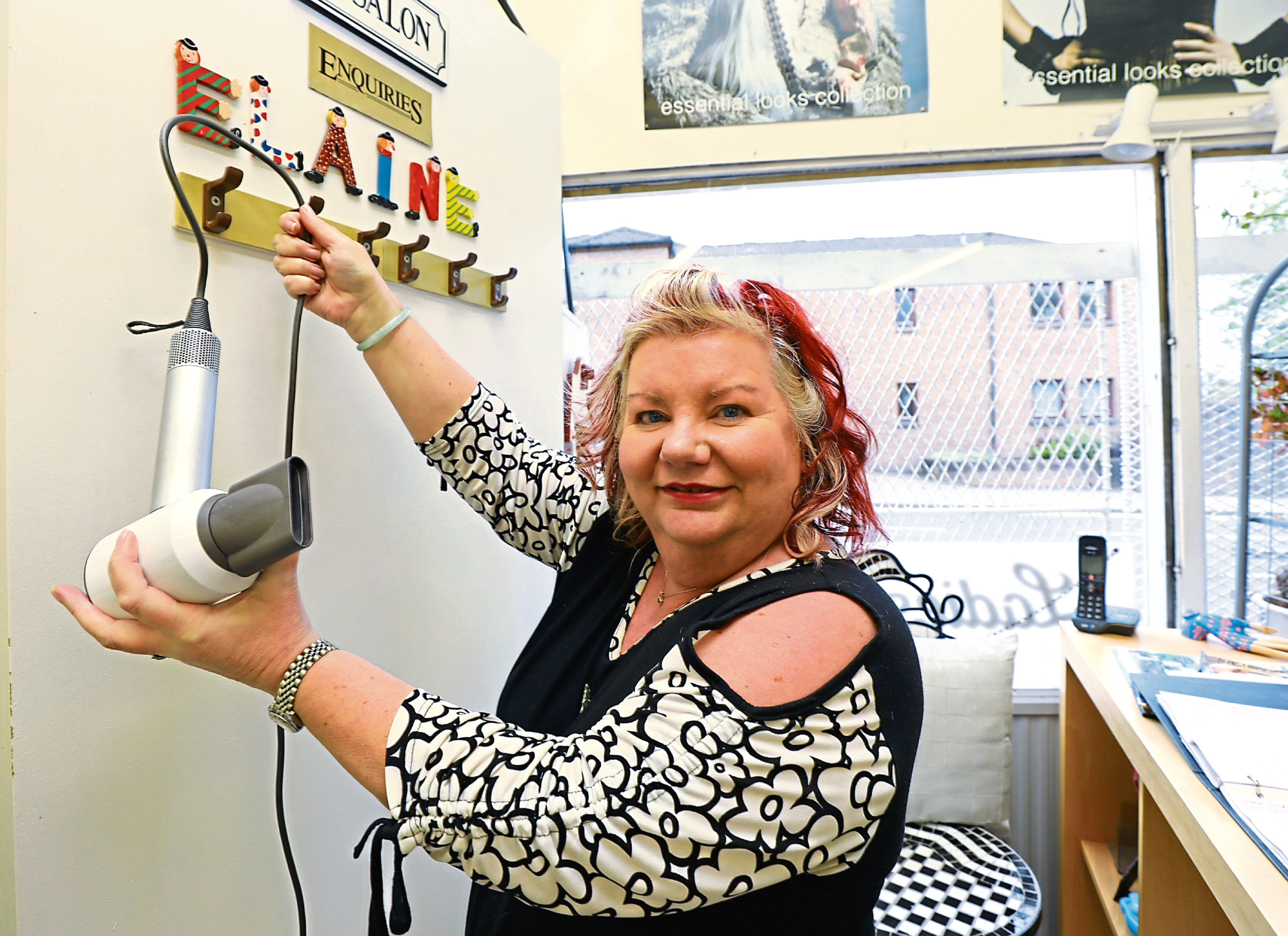 Hanging up her hairdryer, is Elaine Symington, who is retiring after 33 years in Elaine's Hairdressers.