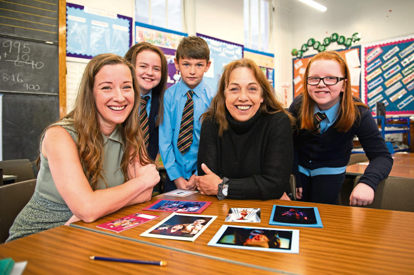 Pupils who were the 'reporters' with their subjects from The Rep ensemble cast. From left: Emily Winter, Kharis Robertson (11), Ryan Duthie (10), Irene Macdougall and Chloe Bebe (10), St Marys RC Primary School.
