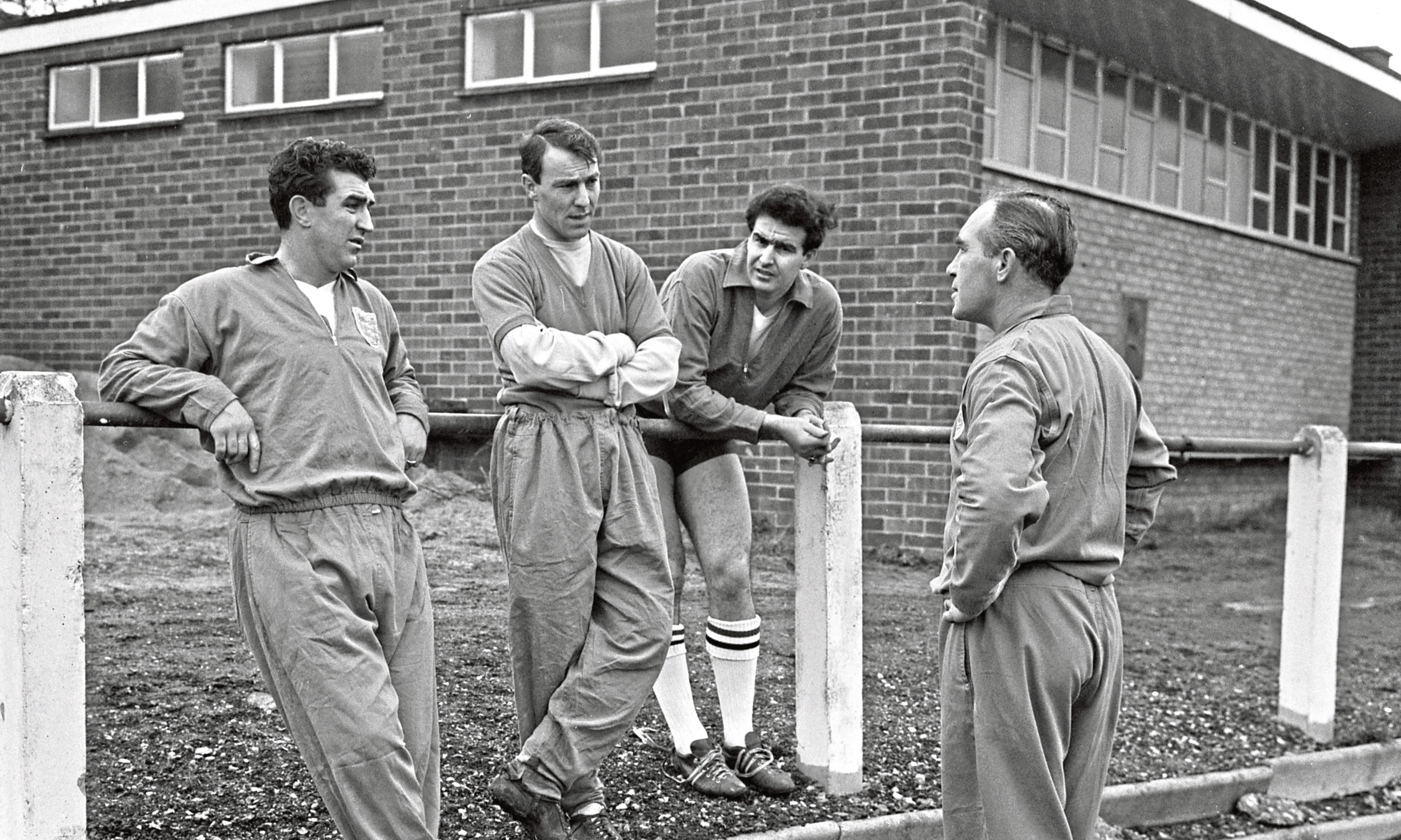 Three England players, Bobby Smith (left) Jimmy Greaves (centre) and Maurice Norman (right) are pictured talking to manager Alf Ramsey before the international match against Scotland.