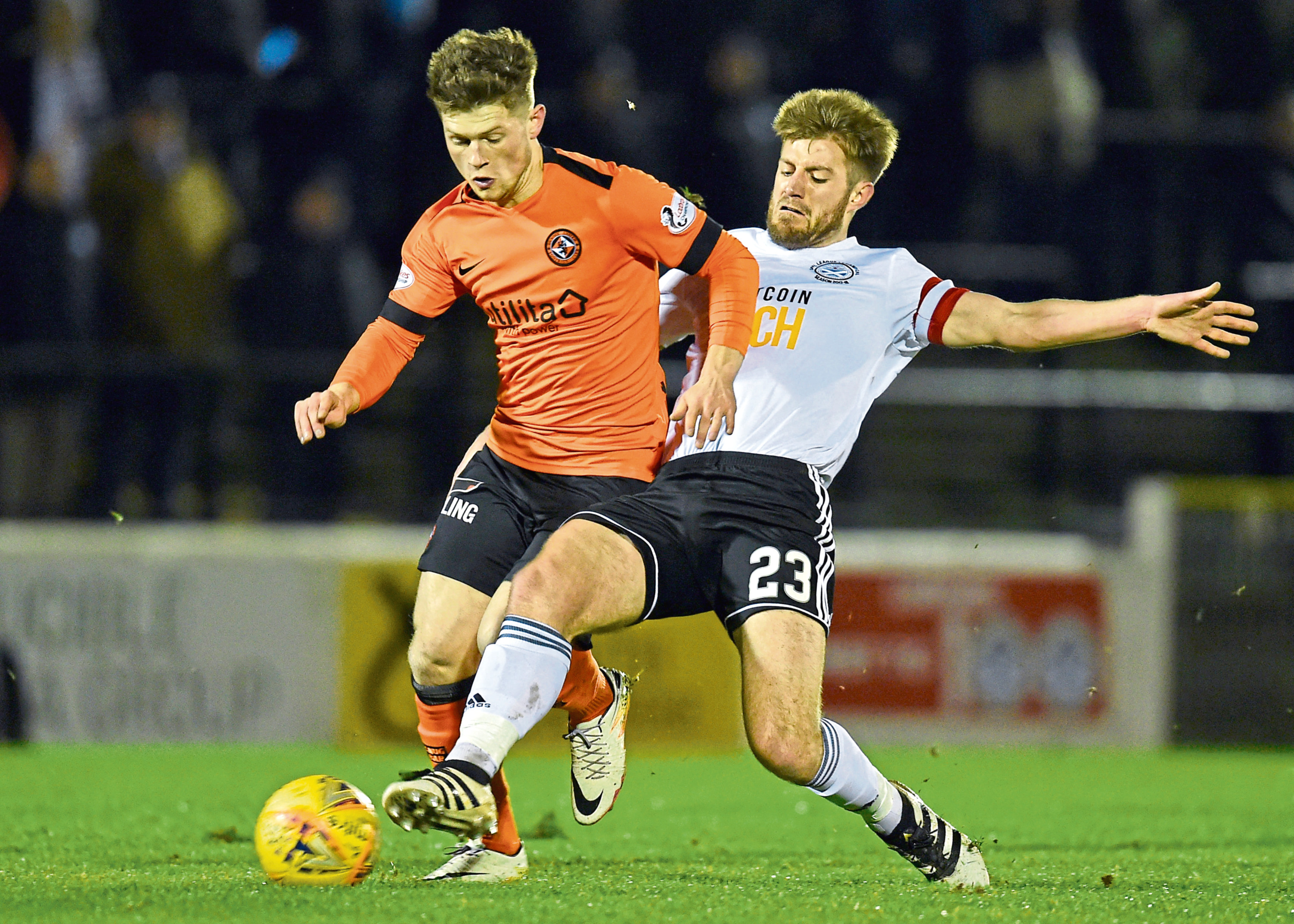 Ayr captain Ross Docherty in action against Dundee United's Cammy Smith (left).