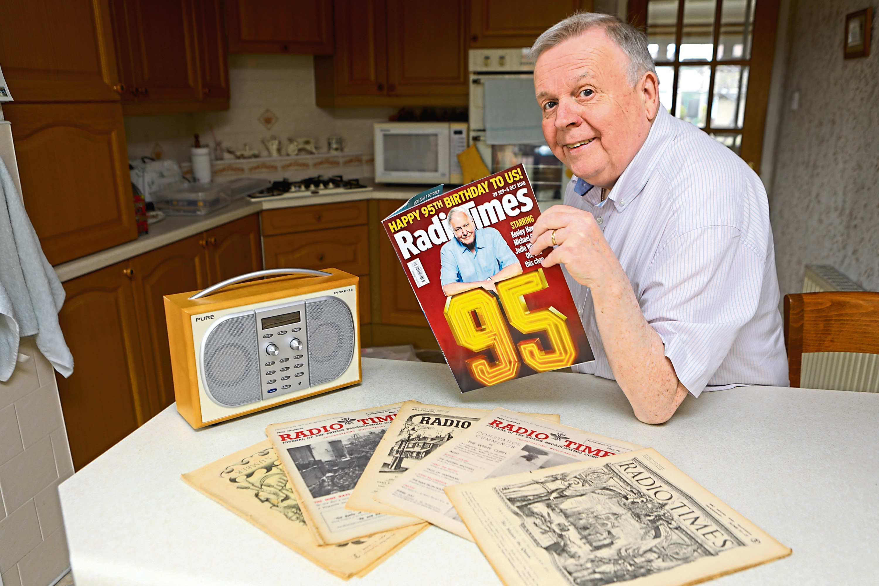 Tom Cairns with one of his many copies of the Radio Times, at home in Dundee.
