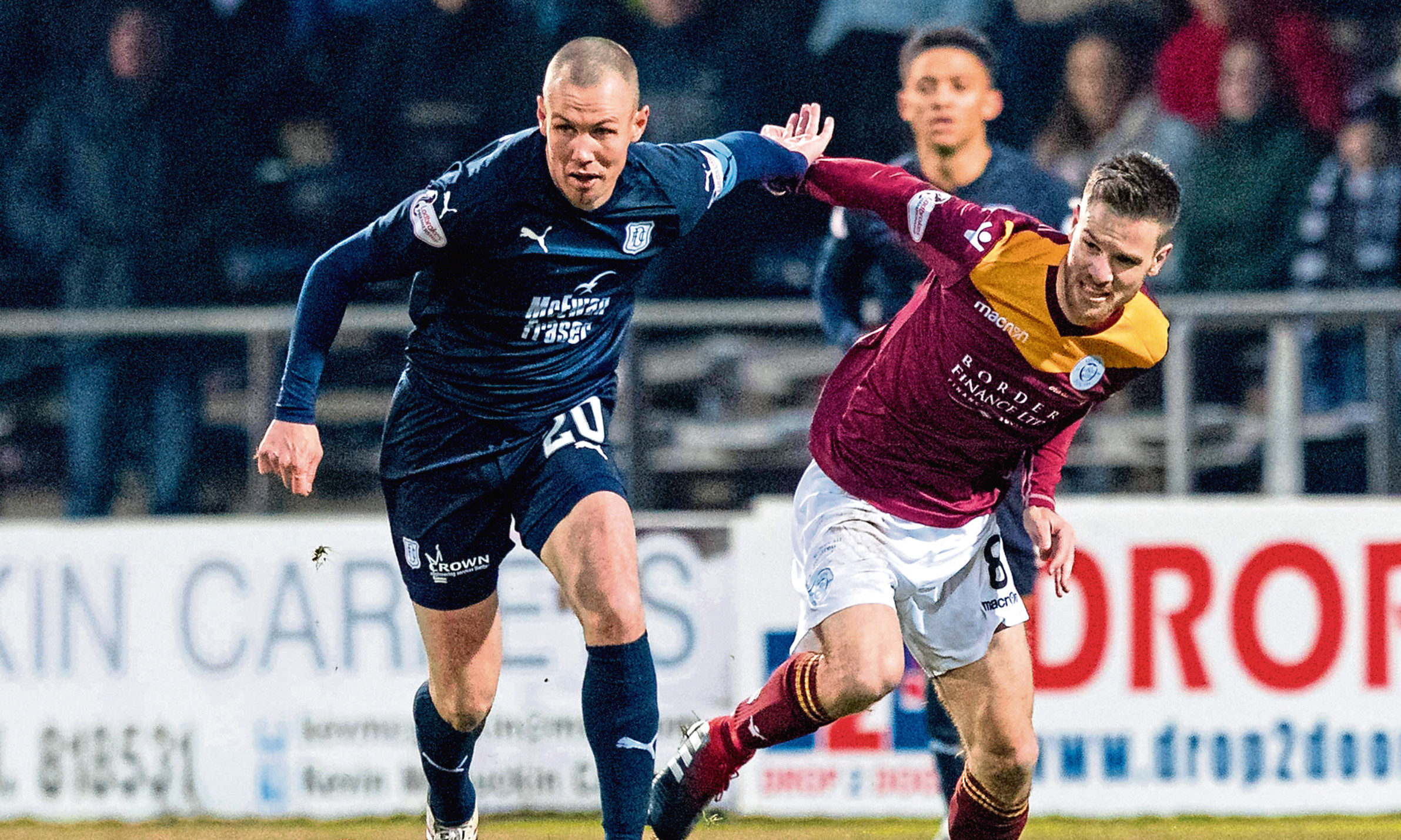 Kenny Miller in action for the Dark Blues.