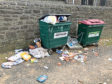 Residents have raised concerns about bin uplifts after dirty nappies and food waste were left lying on city streets.