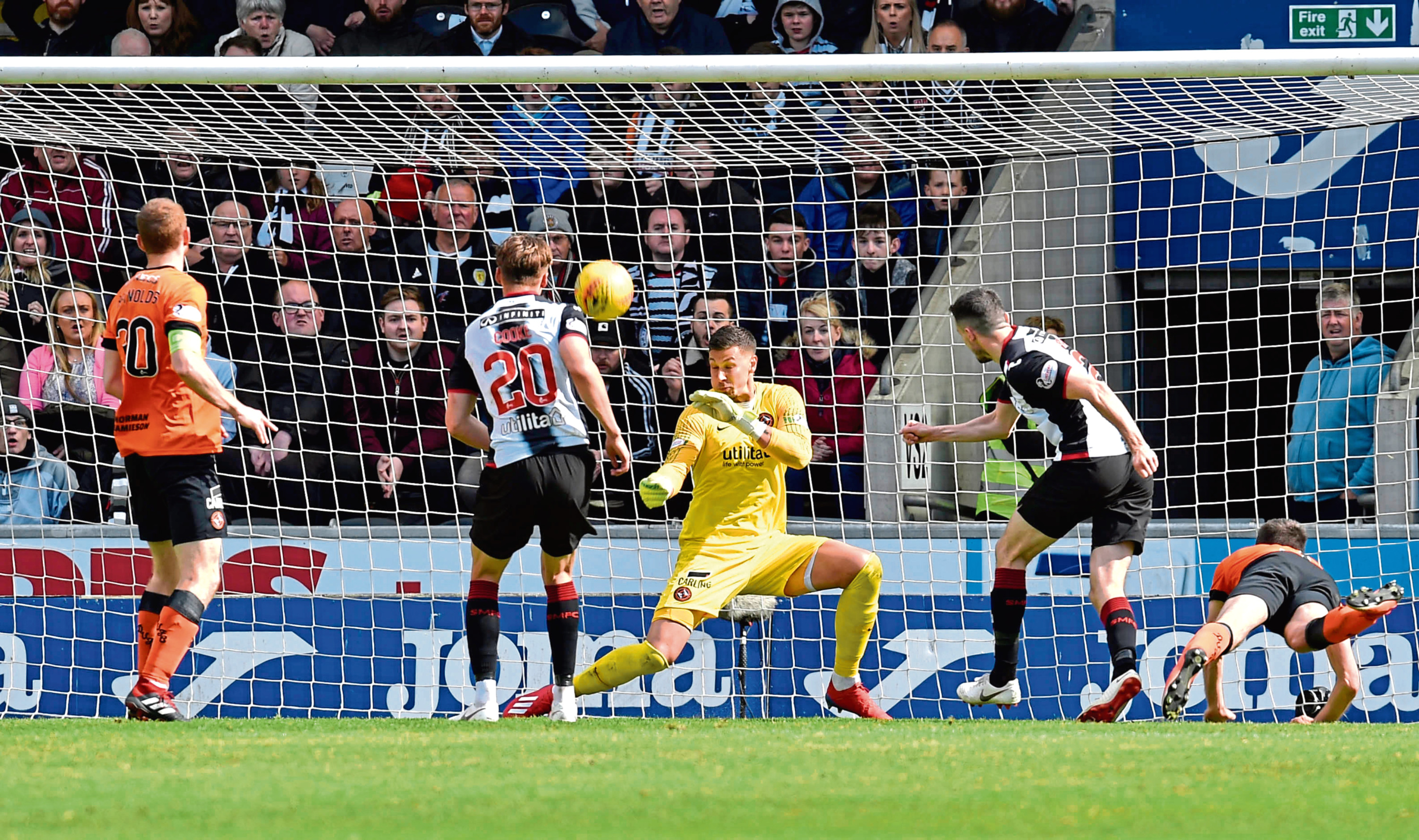 St Mirren's Paul McGinn has his headed chance saved from Dundee United's Benjamin Siegrist.