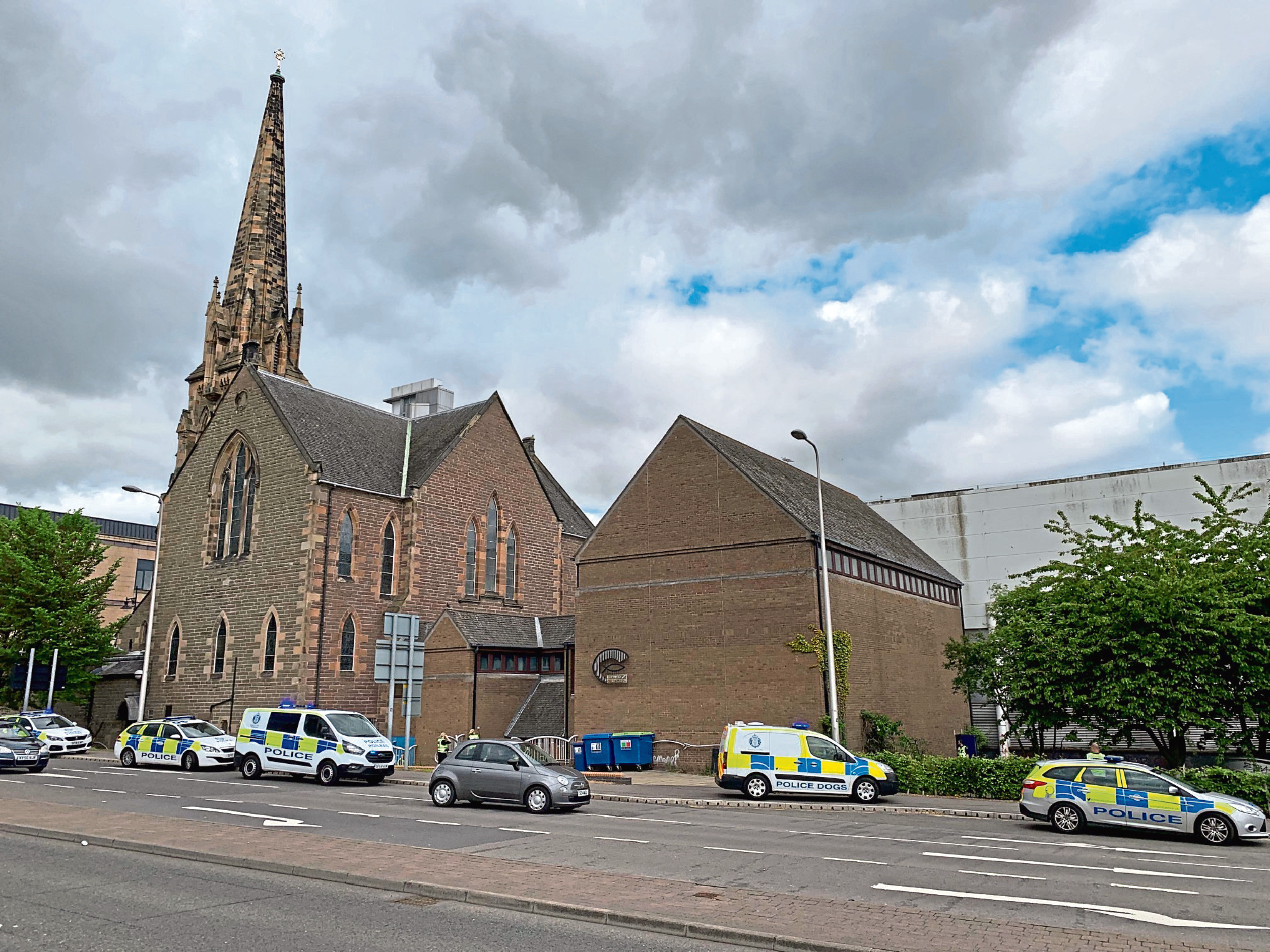 Police outside Meadowside's St Paul's Church.