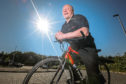 Arthur Booth got on his bike to ride the 1,048 miles from the Perth Porsche premises to Germany.
