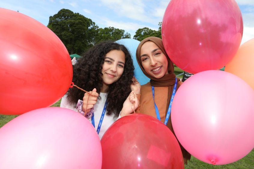 Volunteers Hagar Manssour (18) & Fatima Rehman (24).
