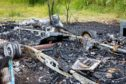 Remnants of a caravan which was on fire at the weekend.