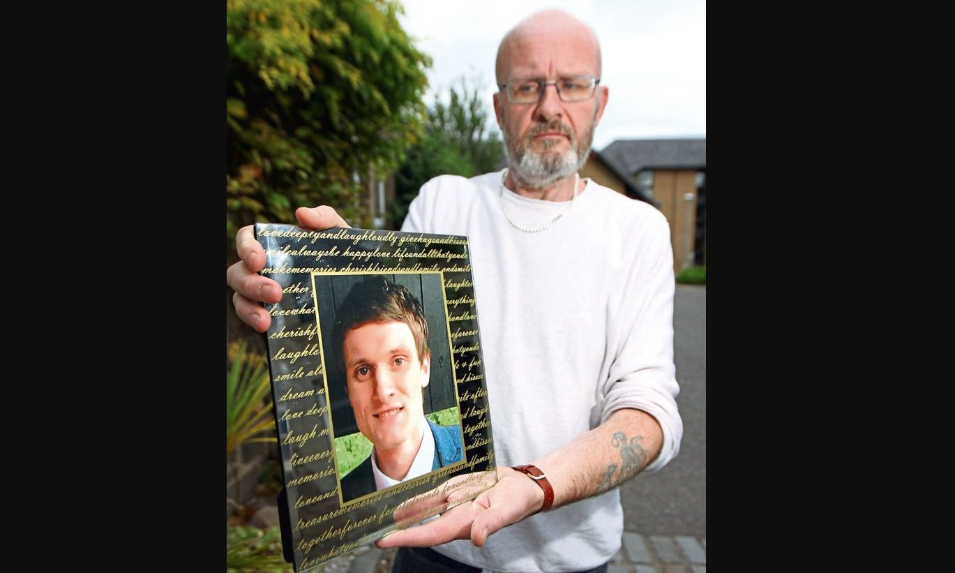 Phil Welsh with a picture of his beloved son Lee, who took his own life in 2017.