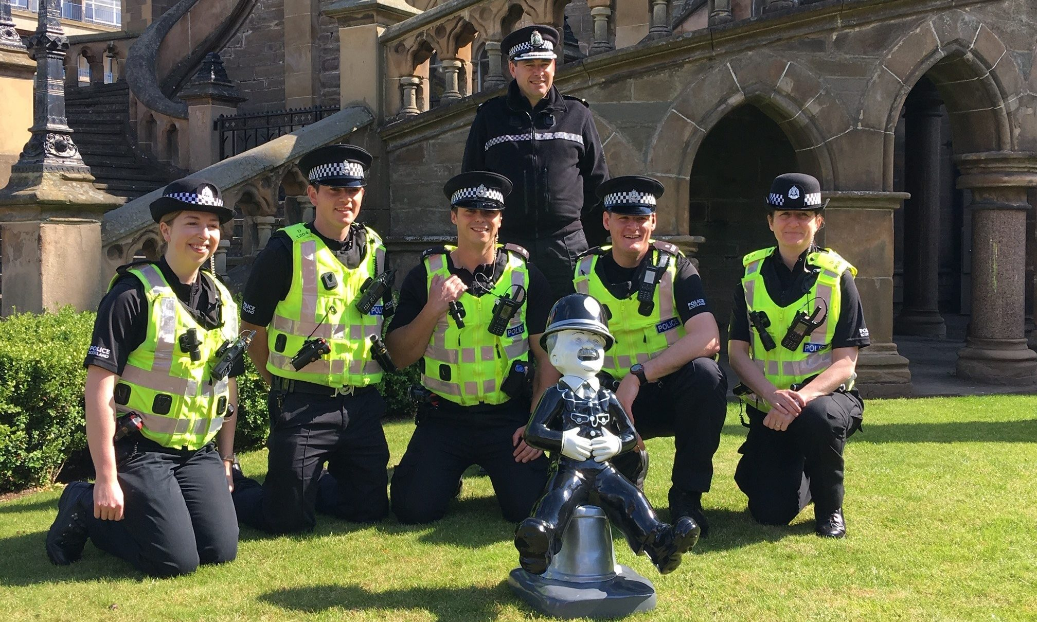 Officers with the statue outside the McManus Galleries.