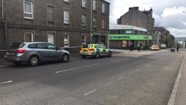 Police at the scene in Albert Street, with a cordon in place.