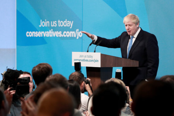 Newly elected British Prime Minister Boris Johnson speaks during the Conservative Leadership announcement at the QEII Centre on July 23.