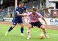 Dundee left-back Jordan Marshall puts pressure on Jack Leitch of Peterhead.