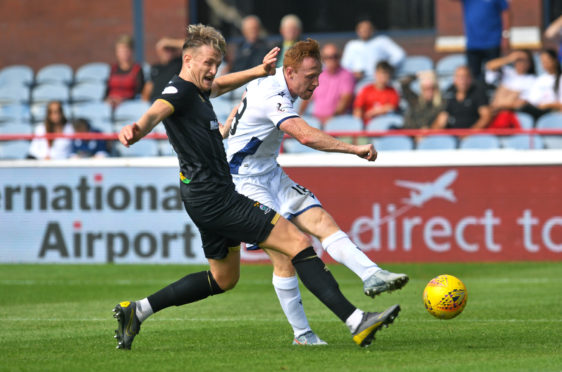 Danny Johnson nets on his Dundee debut to send the Dark Blues through.