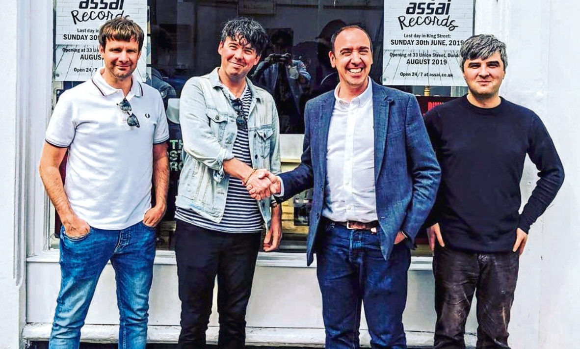 Billy, second from left, shakes hands with Keith Ingram, owner of Assai Records, along with Billy's manager Sean Cruickshank, left, and Matthew Marra, manager of Assai Records.