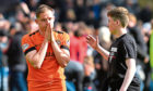 United's Peter Pawlett is comforted by a fan after the play-off disappointment against St Mirren.