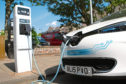 An electric car on charge at a charging point in South Tay Street.