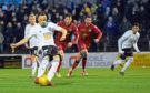 Lawrence Shankland scores a penalty for Ayr.