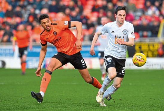 Lewis Smith of Ayr takes on Dundee United's Osman Sow earlier this year.
