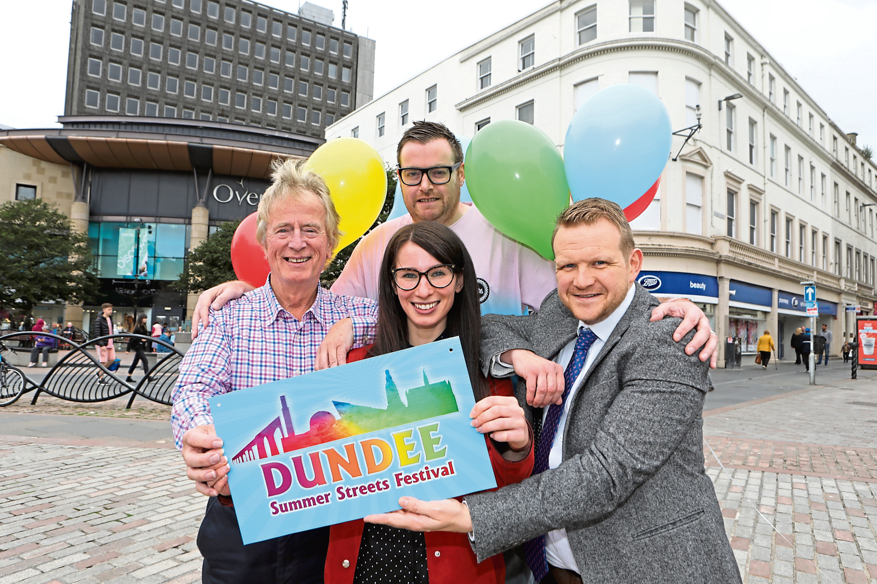 From left: Andi Lothian, from Insights, Metta Ramsay, retail manager of the Overgate, and councillor Alan Ross.  Behind Metta is David Hamilton of Ninja Kiwi.