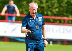 Dundee have confirmed the departure of assistant manager Jimmy Nicholl