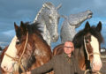 Artist Andy Scott with Clydesdale horses Duke (left) and Baron as he unveils his sculpture The Kelpies.