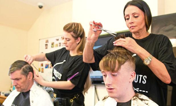 Derek, Megan Gargaro (Hairstylist), Charlie Taylor (Salon Owner) and John at the Salvation Army.