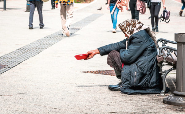 A woman beggging. (Stock image).