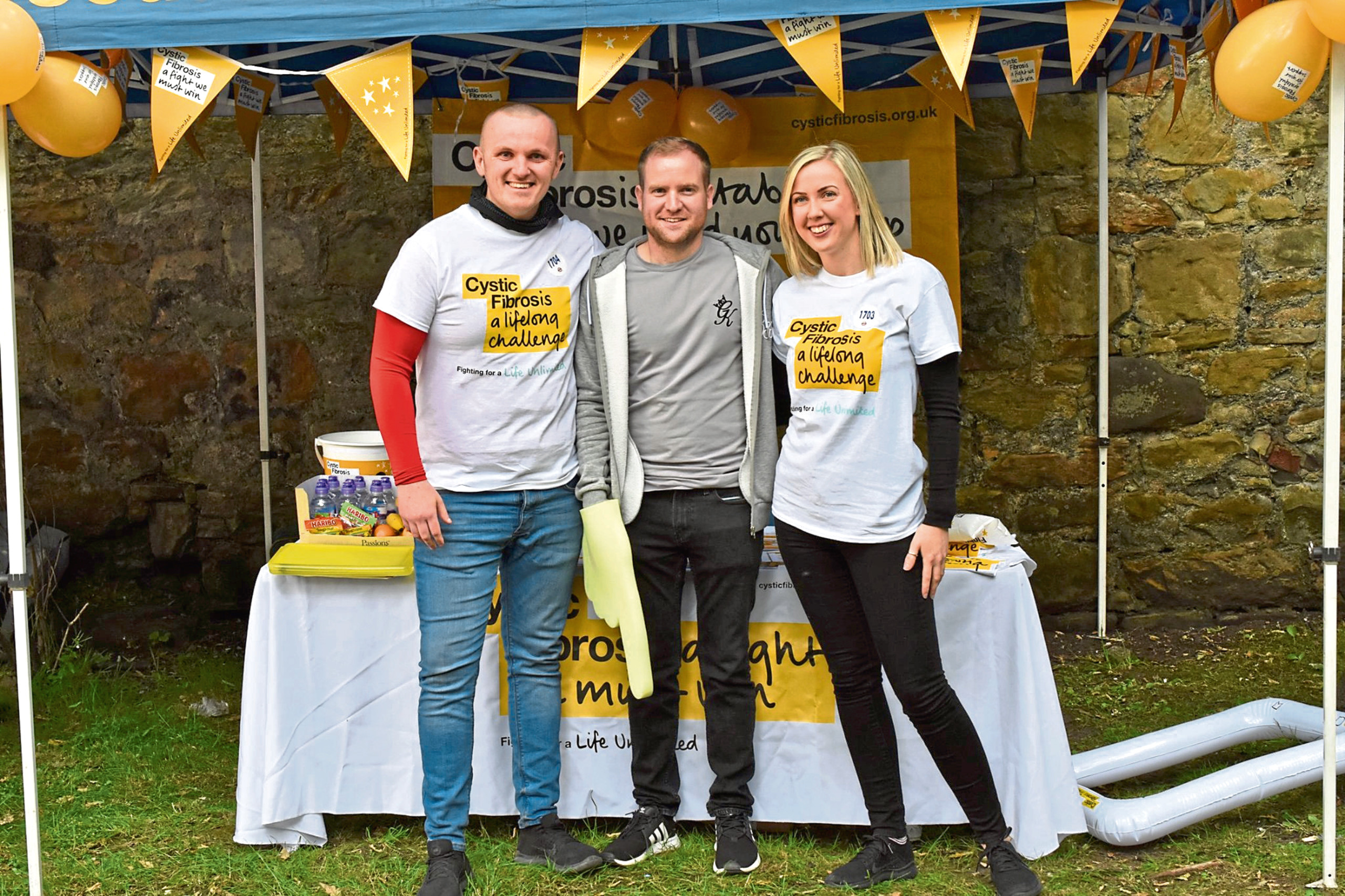 Lisa Marshall and Brad McKerchar abseiling in aid of Cystic Fibrosis Trust Lisa's brother Robbie has the condition.