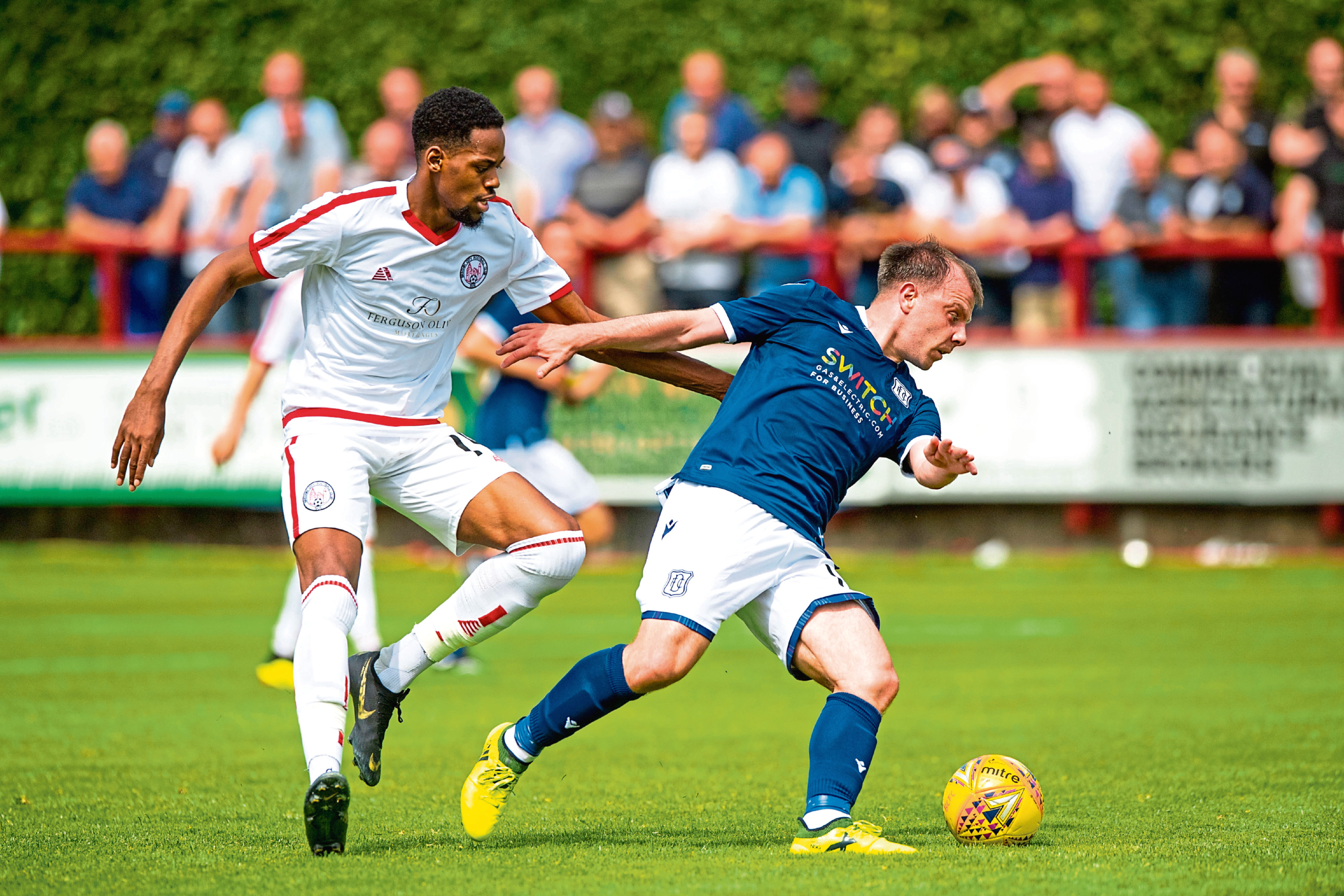 Dundee's Paul McGowan in action against Brechin.