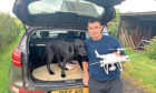 Dale Summerton with Buster and his drone he used to find the missing dog.