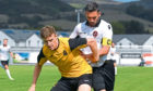 Dundee Uniteds Nicky Clark in action against Dumbarton in a pre-season friendly.