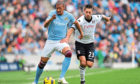 Jerome Boateng (left) and Fulham's Clint Dempsey (right) battle for the ball.