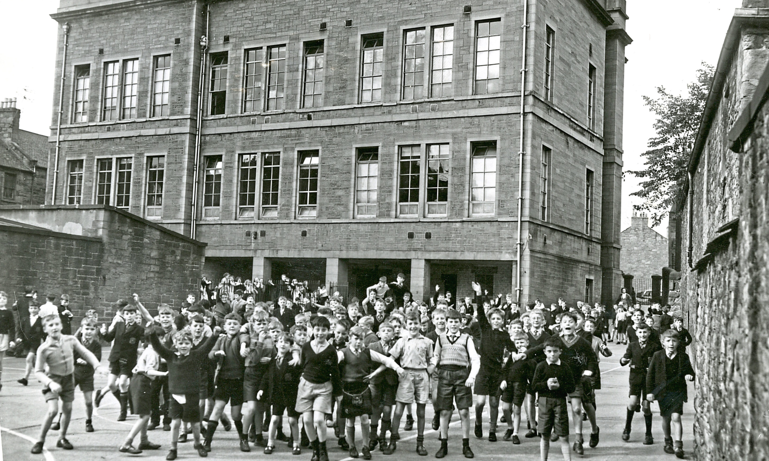 Exterior shot of Hawkhill School playground and pupils. September 14 1961.