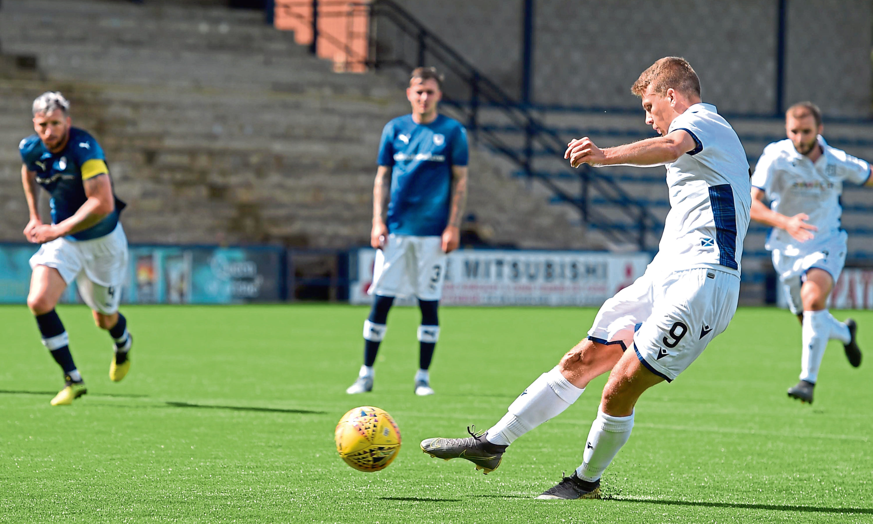Andrew Nelson converts from the spot to make it 2-0 to Dundee.