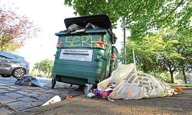 An overflowing Eurobin in Crescent Lane.