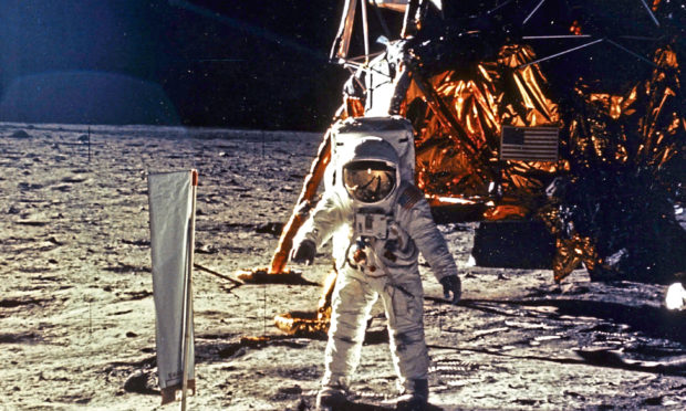 The deployment of scientific experiments by astronaut Edwin Aldrin Jr. is photographed by Neil Armstrong.