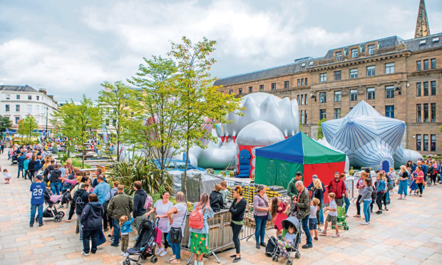 A large queue for the Luminarium in Dundee city centre, during last year's festival.