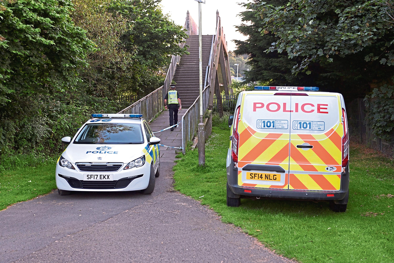 Police search the area around White Bridge, Perth.