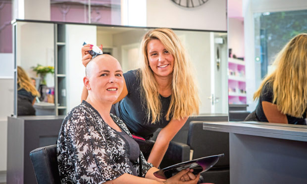 Suzanne Milne after the head shave alongside stylist Melissa Martin.