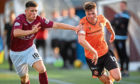 Stenhousmuir's Liam Scullion and Dundee United's Jamie Robson in action.