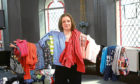 Tele reporter Laura Devlin with some of the clothes donated.